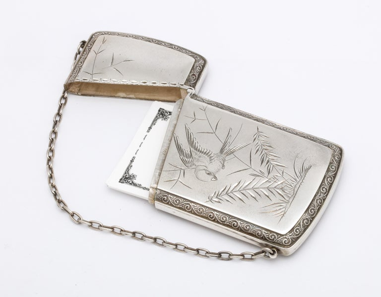 Sterling silver, Aesthetic Movement calling card/business card holder, Gorham Mfg. Co., Providence, Rhode Island, year hallmarked for 1881. One side is bright cut, satin finished and is designed with an etched bird and leaves, the opposite side is