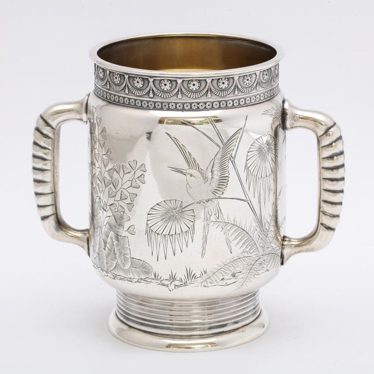 Aesthetic Movement, sterling silver, two-handled mug, Gorham Manufacturing Co., Providence, Rhode Island, year hallmarked for 1878. Lovely etched designs. One side has an etched butterfly flitting among ferns; the opposite side of the mug has an