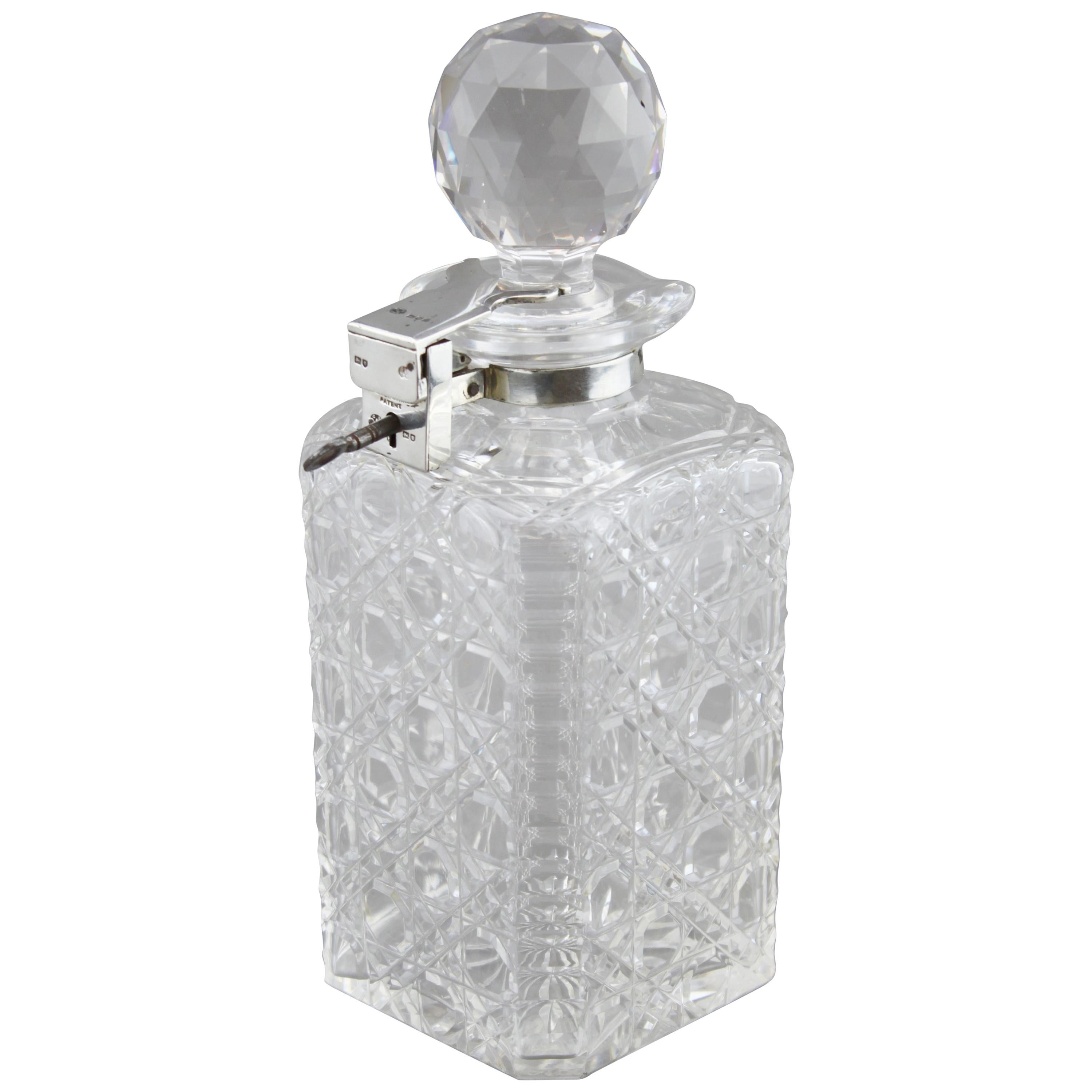Sterling Silver and Crystal Glass Whiskey Bottle, London, 1927