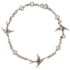 Sterling Silver and Oval Freshwater Pearl Swallow Bracelet