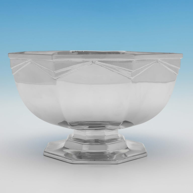 Hallmarked in London in 1932 by Goldsmiths & Silversmiths Co., this very handsome, sterling silver bowl, is octagonal in shape, and has Art Deco influenced decoration to the sides. The bowl measures 5