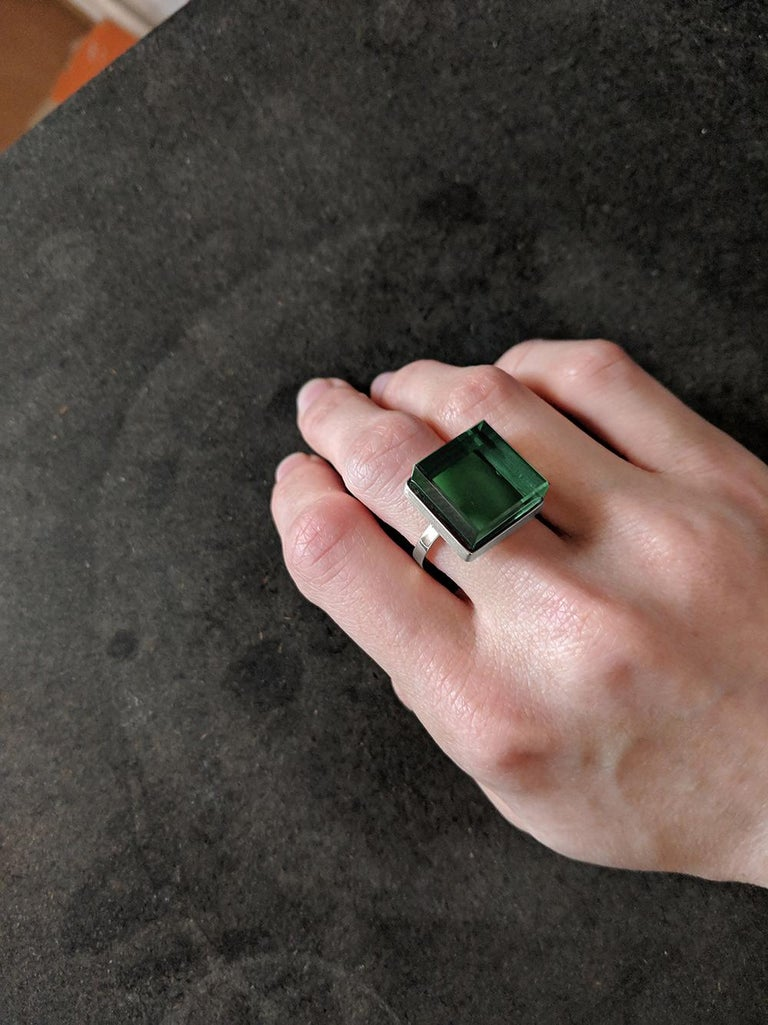 This ring is in sterling silver with 15x15x8 mm grown green quartz. It was published in Harper's Bazaar and Vogue UA.   The ring reflects the art deco spirit and fits to women and men. This ring inspires the architects, designers and the artists. It