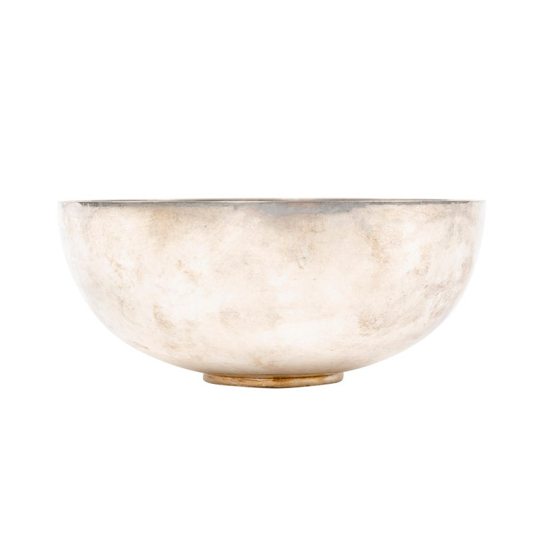 A small Scandinavian Modern sterling silver bowl designed by Piet Hein. Bowl is stamped '1145 B' on its base. Manufactured by Georg Jensen in Denmark, 1960s.