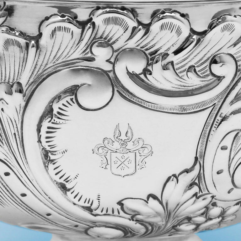 Hallmarked in London in 1897 by Fordham & Faulkner, this attractive, Antique, Victorian, Sterling Silver Bowl stands on a pedestal foot and features chased floral and scroll decoration to the body with reed borders around the foot and rim. The bowl
