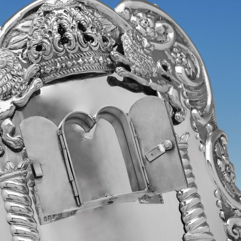 Hallmarked in London in 1916 by Morris Salkind, this fine George V, Antique, sterling silver breast plate, features decoration depiction the tablets with the engraved Ten Commandments in Hebrew, two columns representing the columns of the Temple of