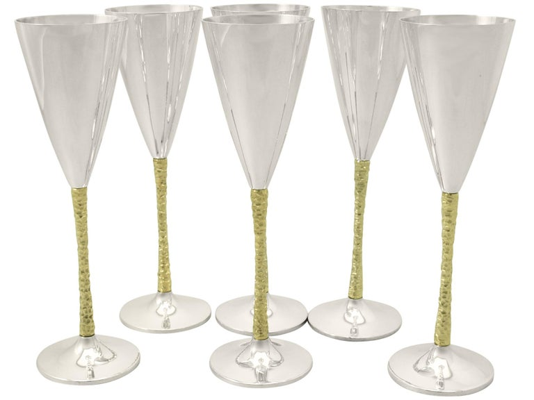 An fine and impressive set of six vintage Elizabeth II English sterling silver champagne flutes made by Stuart Devlin; an addition to our range of collectable silverware.