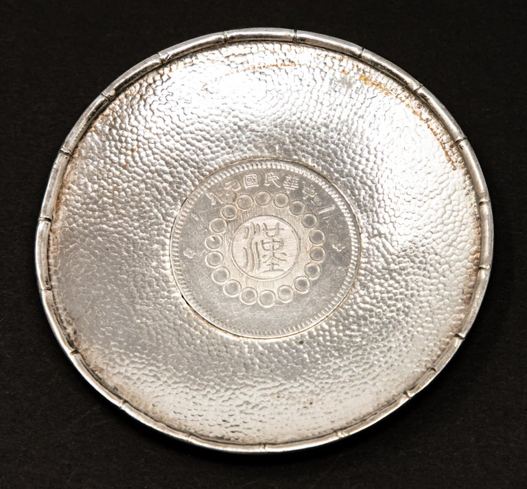 Offering this sterling silver Chinese coin dish. The coin is marked on both sides with Chinese markings.