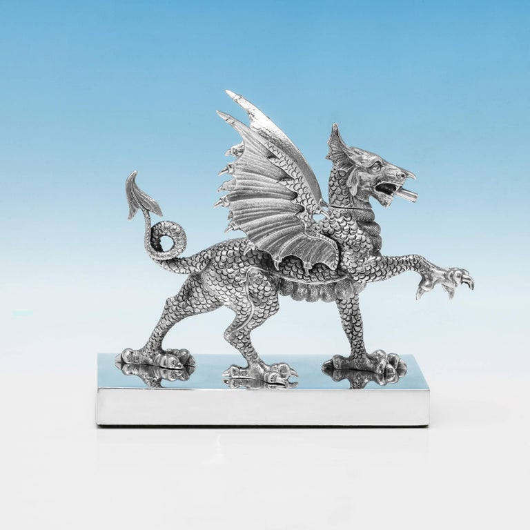 Hallmarked in London in 1972 by Carrington & Co. This fantastic sterling silver cigar lighter takes the form of a dragon, standing on a pedestal base. The head is removable to fill with lighter fluid, with the wick protruding from the mouth. The