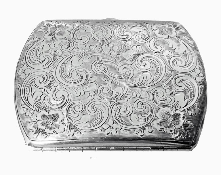 Antique Sterling Silver Cigarette or Card Case, American C.1920. The case of slightly rounded form richly engraved with foliate decoration, possible intricately engraved monogram to one side, but may be part of decoration, orange cabochon carnelian