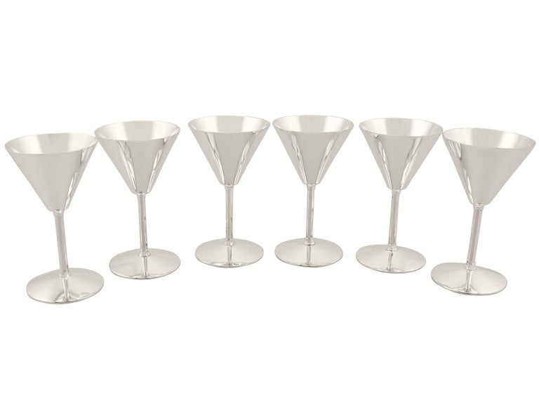 An exceptional, fine and impressive set of six vintage Elizabeth II English sterling silver cocktail glasses in the Art Deco style; an addition to our range of collectable silverware  These exceptional vintage sterling silver cocktail glasses have a