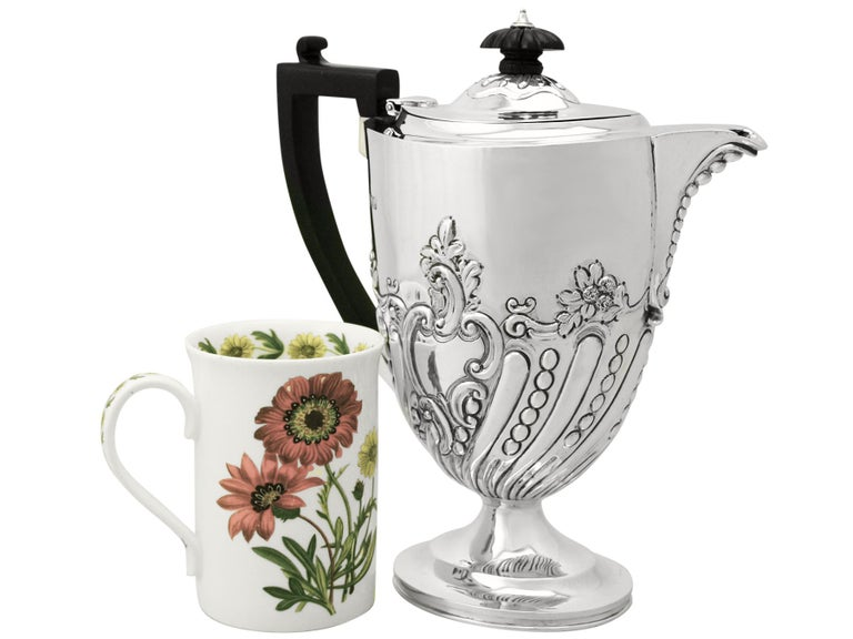A fine and impressive antique Victorian English sterling silver coffee jug made by Charles Stuart Harris; an addition to our range of silver teaware.  This fine antique Victorian sterling silver coffee jug has an oval rounded Queen Anne form onto
