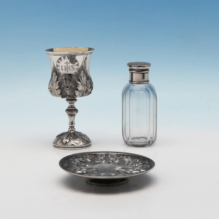 Hallmarked in London in 1872 by Charles Reily & George Storer, this fine antique, Victorian, sterling silver communion set comprises of a chalice with gilt interior measuring 4