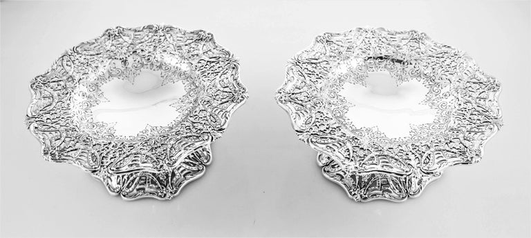 American craftsmanship at its finest! This pair of compotes made by Black Starr & Frost have scalloped edges both on top and along the base-- giving them a