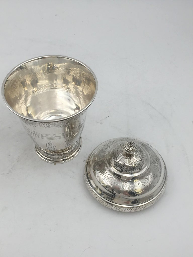 Sterling silver, engraved covered Kiddush cup / beaker finely engraved with spiral finial atop by Tane. Measuring 7'' in height and 3 7/8'' in diameter. Weighs 11.5 ozt. Bearing hallmarks as shown.  Tane has been established in Mexico City since