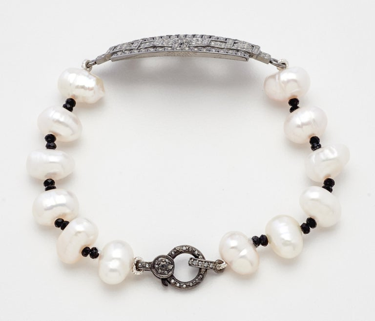 Created by Susan VanGilder with an eclectic mix of vintage and artisan styling, this beautiful Sterling Silver & Diamond Placket Bracelet with Baroque Akoya Pearls & Genuine Black Spinel is a versatile piece for most tastes and occasions.  Measuring