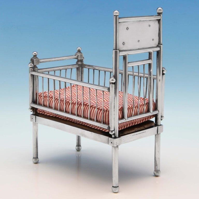 Hallmarked in London in 1902 by William Comyns, this fabulous Edwardian Antique, Sterling Silver Doll's House Cot is very realistic and is presented with a handmade mattress. The headboard bears the words