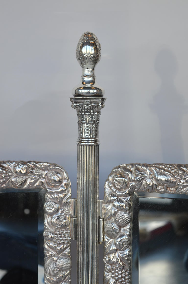 Early 1900s bronze silver plated vanity mirror.