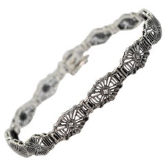 Sterling Silver Filigree Bracelet with Diamond Accents