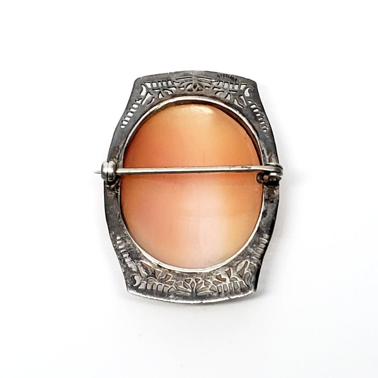 Vintage sterling silver filigree cameo pin.  This carved stone cameo features a lady in profile, bezel set in a lovely filigree sterling silver frame.  Size: 1 5/8