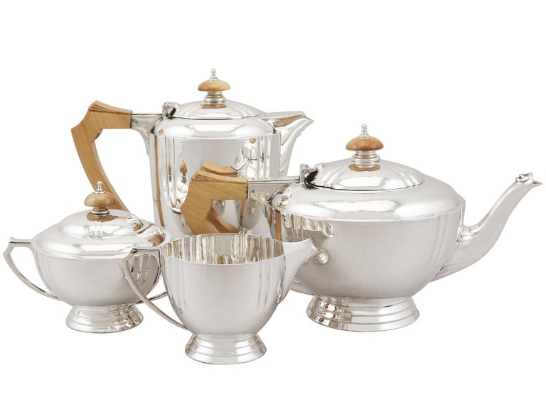 An exceptional, fine and impressive vintage George VI English sterling silver four piece tea and coffee set and matching tray; an addition to our silver teaware collection.  This exceptional vintage George VI sterling silver four piece tea and
