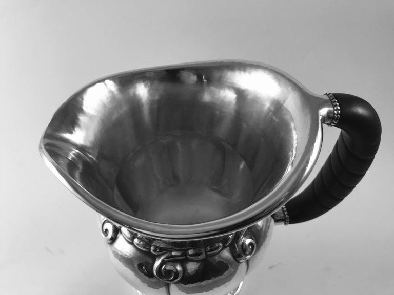 sterling silver georg jensen pitcher with ebony handle. Black Bedroom Furniture Sets. Home Design Ideas