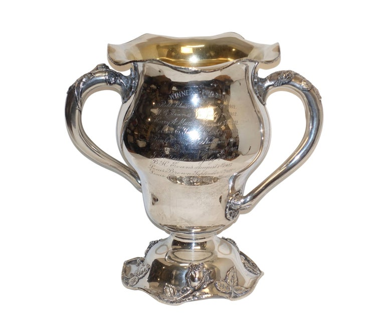 A large sterling silver trophy for Pittsburgh, Hotel Country Club. Schenley golf cup won by Boris Brown, the reverse side engraved with winners pro tem 1902 and 1903. Having a gold wash interior and marked on the underside with an 'M' above a leaf
