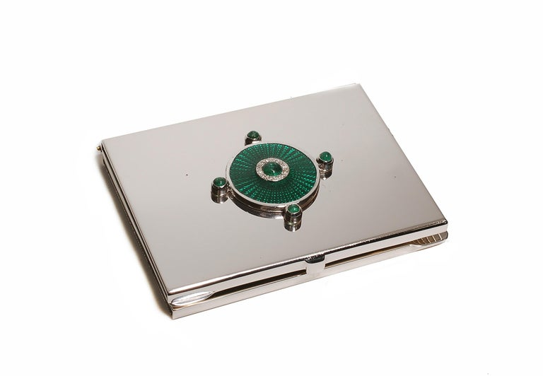 20th-century sterling silver Guilloché green enamel mirror case One of a kind mirror case  Cabochon emeralds weighing 0.65 carats Diamonds weighing 0.15 carats Handmade in Italy White gold plated  The Ocie Minaudiere collection was created to
