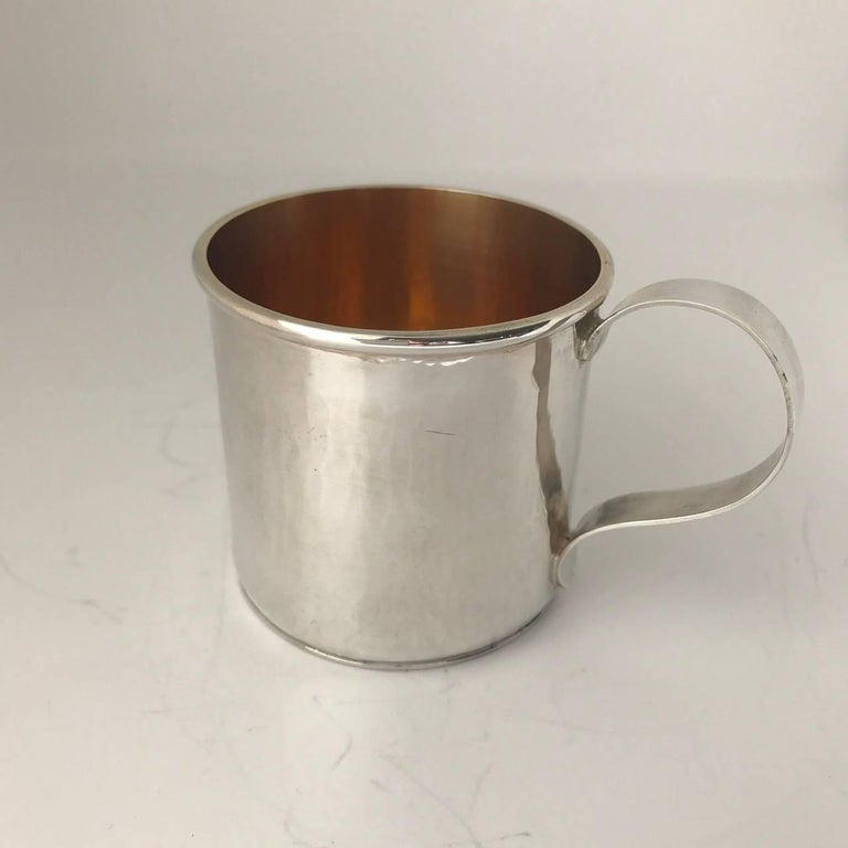 Sterling silver hand-wrought baby/youth cup.  Beautifully hand-hammered, very heavy weight with a 24-karat gilt interior.  Can be hand engraved for an additional charge.  Local San Francisco artisan made. Excellent quality.