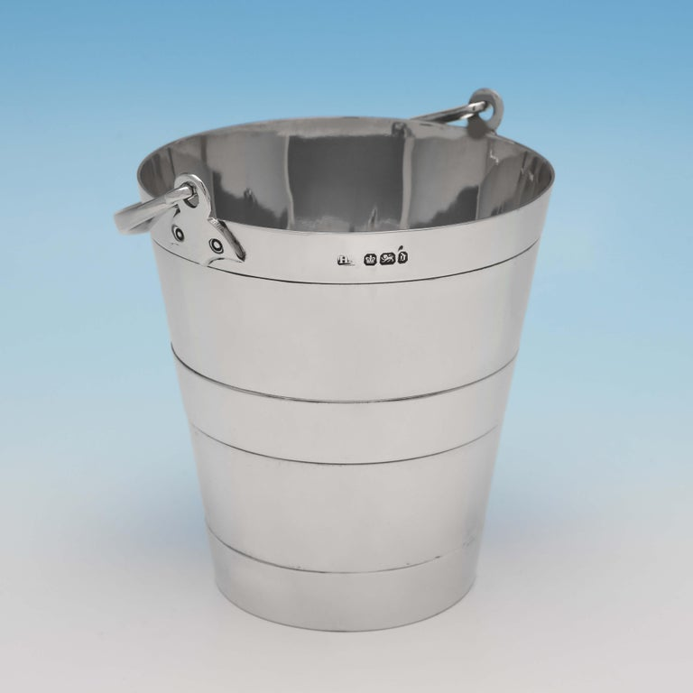 Hallmarked in Sheffield in 1896 by Henry Atkin, this very handsome, Victorian, antique sterling silver ice bucket, is plain in style, and bucket shaped. The ice bucket measures 4.75