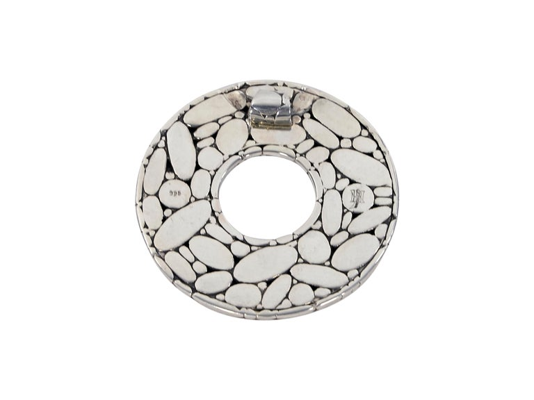 Product details:  Sterling silver circular pendant by John Hardy.  Cutout center.  2.5