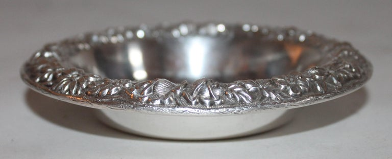This sterling silver bon bon bowl is signed sterling & S. Kirk & Sons Inc. This is a heavy bowl and looks like a finger bowl or candy dish. Very well made and full of detail work. This small bowl is a rare find.