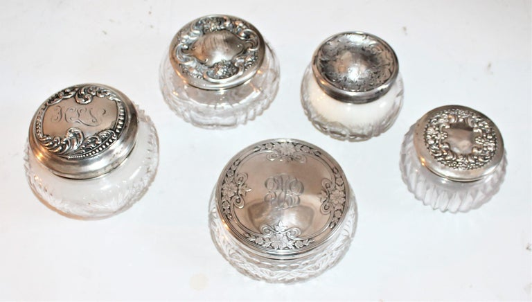 Measurements are as follows from left to right and center piece being last in measurements. Sterling silver lided cut glass jars. 4.5 x 4 , 3.5 x 3 , 3.5 x 2.75 , 4.5 x 3 , 5 x 2.3