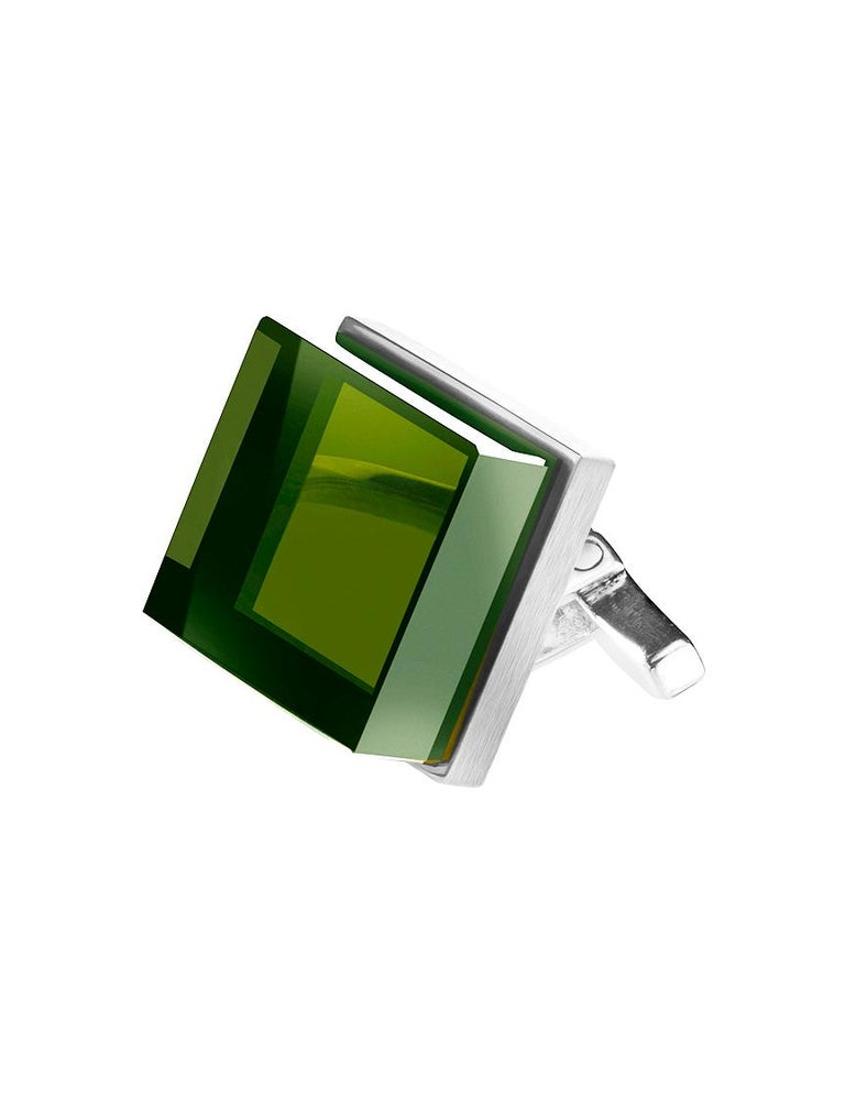 These art deco style cufflinks are in sterling silver with 10x10x6 mm grown green quartzes, very attractive for the eyes because of placement opened for the light and the vivid cold green colour.   This Ink collection was chosen by the fashion