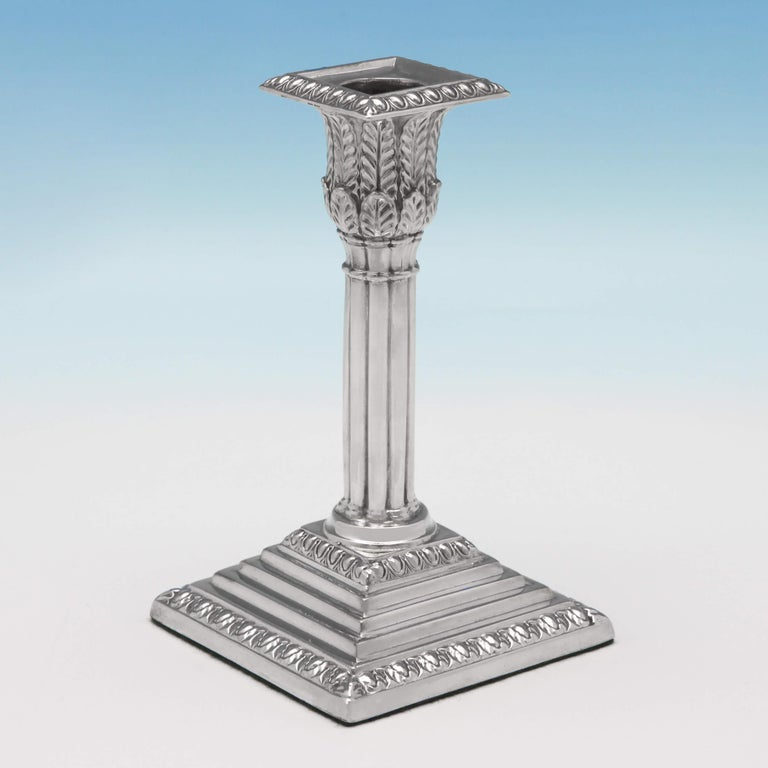 Hallmarked in Sheffield in 1874 by James Kebberling Bembridge, this attractive, Victorian, antique sterling silver pair of candlesticks, stand on square stepped bases, and feature bamboo columns, acanthus leaf decoration to the capitals, and