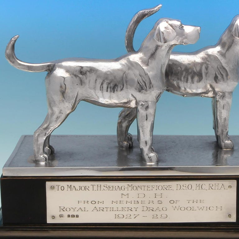 Hallmarked in London in 1929 by Blackmore & Fletcher Ltd. This handsome pair of sterling silver hound dogs stand proudly on a wooden plinth, and comprise a female and male dog, which is rare to see. The plinth bears an engraved plaque which reads: