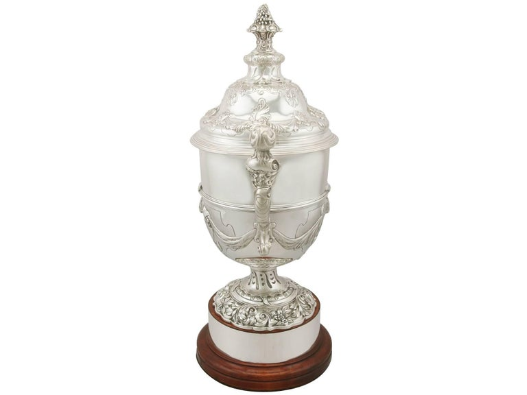 A magnificent, fine and impressive, large antique George V English sterling silver presentation cup and cover made in a Paul de Lamerie design; an addition to our presentation silverware collection  This magnificent antique George V sterling