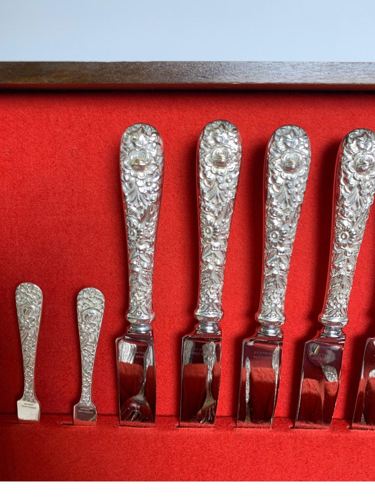 A set of Kirk & Son sterling flatware. Classic repousse consisting of 8 knives, 8 dinner forks, 8 salad forks, 8 iced tea spoons, 8 coctail forks, 11 teaspoons, 6 serving spoons, 2 butter knives, 1 meat fork, 1 carving fork, 1 carving knife, 2 berry