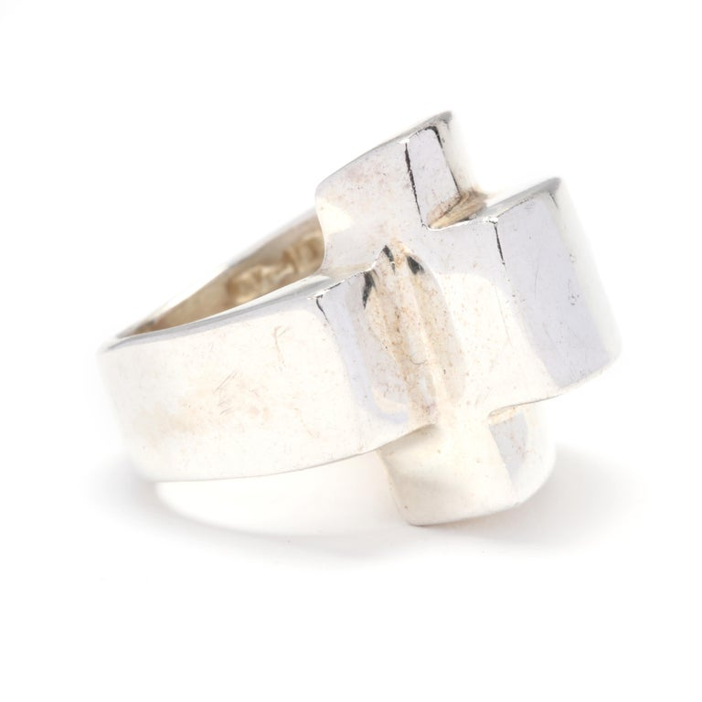 A sterling silver ridged statement ring. A domed ring with a rectangular ridged crossover motif and a tapered shank.  Ring Size 6.25  Length: 13/16 in.  19.35 grams  * Please note that this is a vintage item and may show signs of wear. It has been