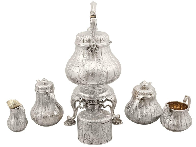 An exceptional, fine and impressive antique Victorian English sterling silver six piece bachelor tea and coffee service; an addition to our silver teaware collection  This exceptional antique Victorian six piece sterling silver tea service / set