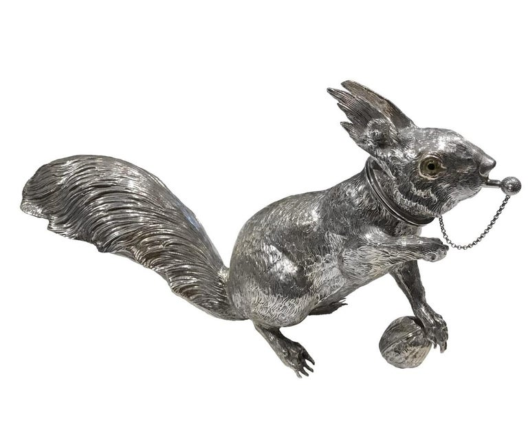 Exceptional large and realistic solid sterling silver cocktail shaker in the form of a squirrel. Focused, holding a nut in its paw and is about to pounce at the slightest alert. The shaker is finely chiseled with many realistic details. The head is