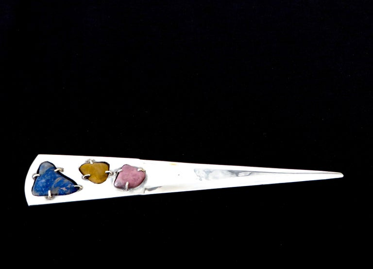 Very modern abstract sterling silver letter opener with inlaid semi precious stones, of lapis, tigers eye and rhodochrosite. Stamped Taxco, JLP, Sterling. In excellent condition. No scratches or nicks to the point of the opener.