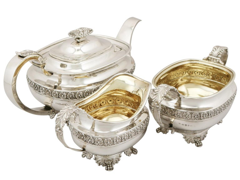 An exceptional and impressive antique George IV English sterling silver Regency style three piece tea service/set; an addition to our silver teaware collection.  This antique George IV sterling silver three piece tea service consists of a teapot,