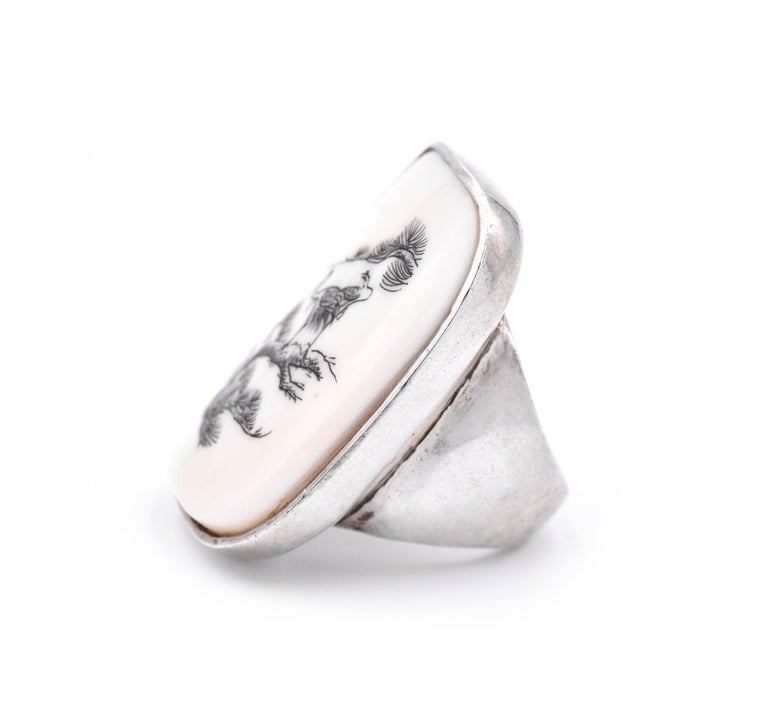 Material: sterling silver Ring size: 10 (please allow up to two additional business days for sizing requests) Dimensions: ring band measures 41.35mm X 30.77mm Weight: 40.21 grams