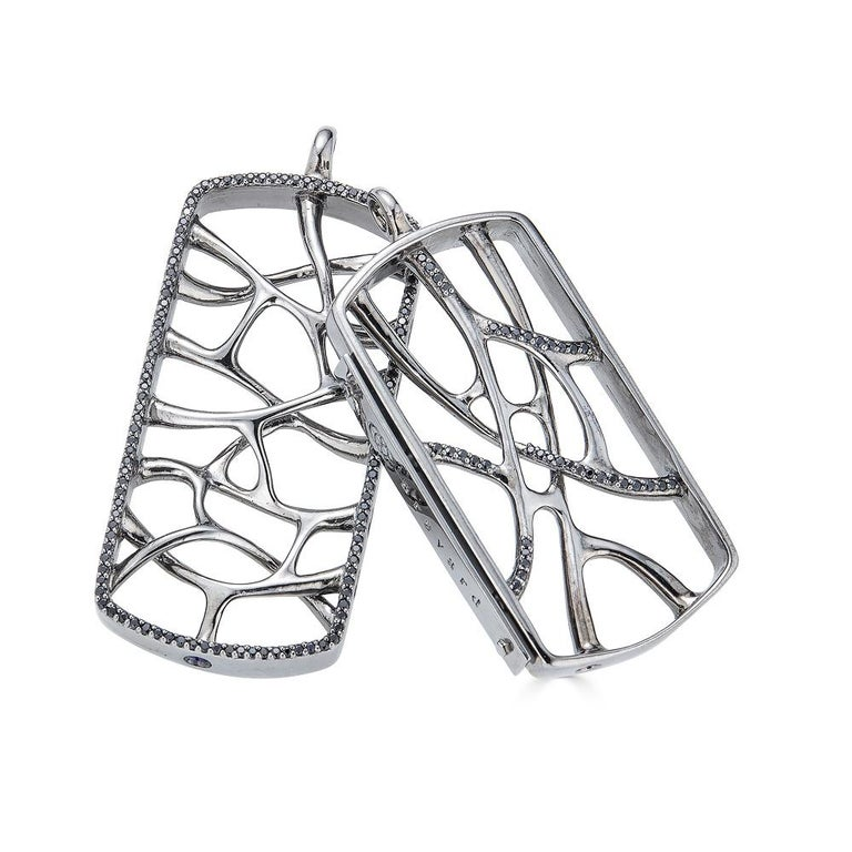 This Sterling Silver Web Dog Tag Necklace is inspired by the fractal and natural root systems. This intricately crafted, limited edition necklace features morphogenic patterns and is part of designer John Brevard's Morphogen collection. The