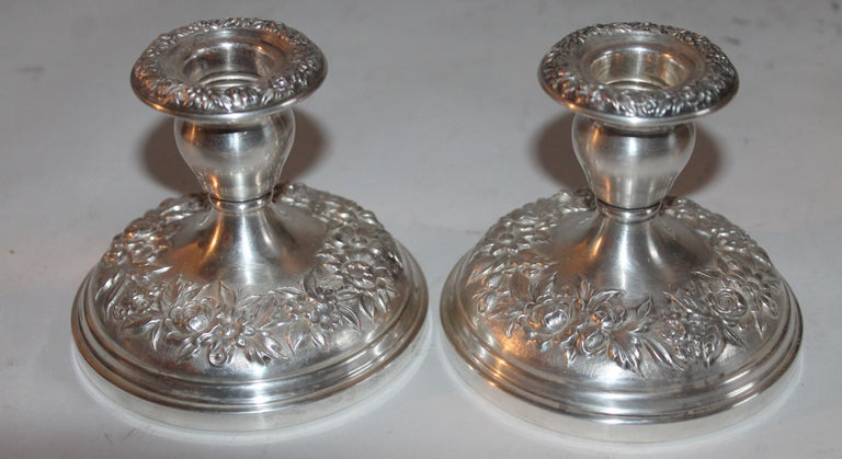 4.75 x 3.75 candle sticks/ These heavy sterling silver S.Kirk & Sons weighted candle holders are in pristine condition.