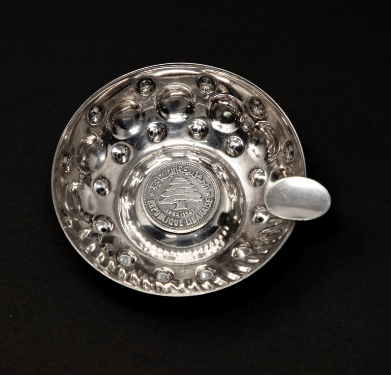 Offering this sterling silver wine taster with a Republic Libanaise coin. Has lots of handcrafted raised dots.