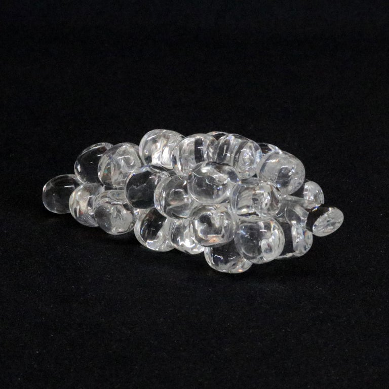 Midcentury Steuben figurative mouth blown crystal fruit sculptural paperweight features colorless art glass in full body form of Grape Cluster designed in the 1940s by Corning Museum of Glass, New York, NY, signed on base, 20th century  Measures -