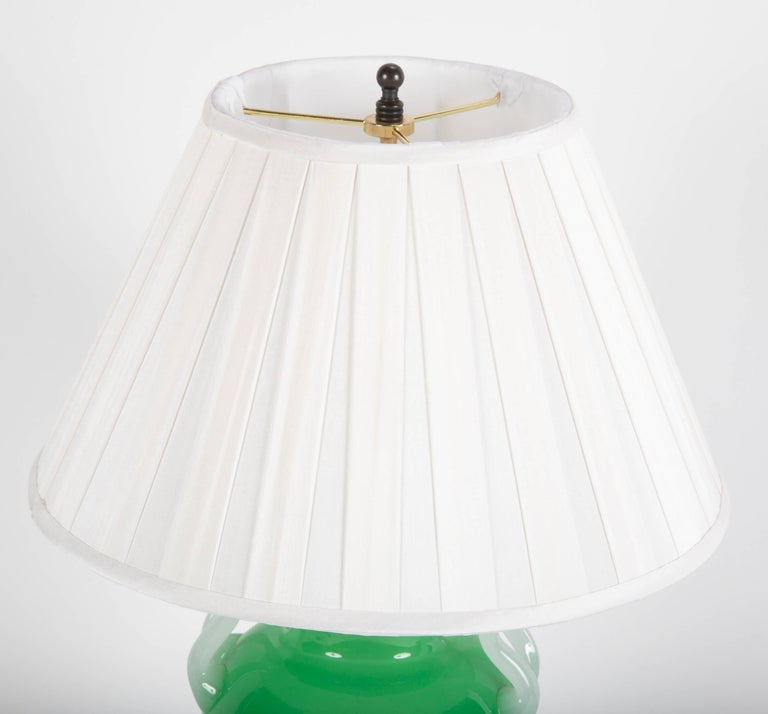 A jade green Steuben glass vase now electrified and mounted as a table lamp. Unsigned.