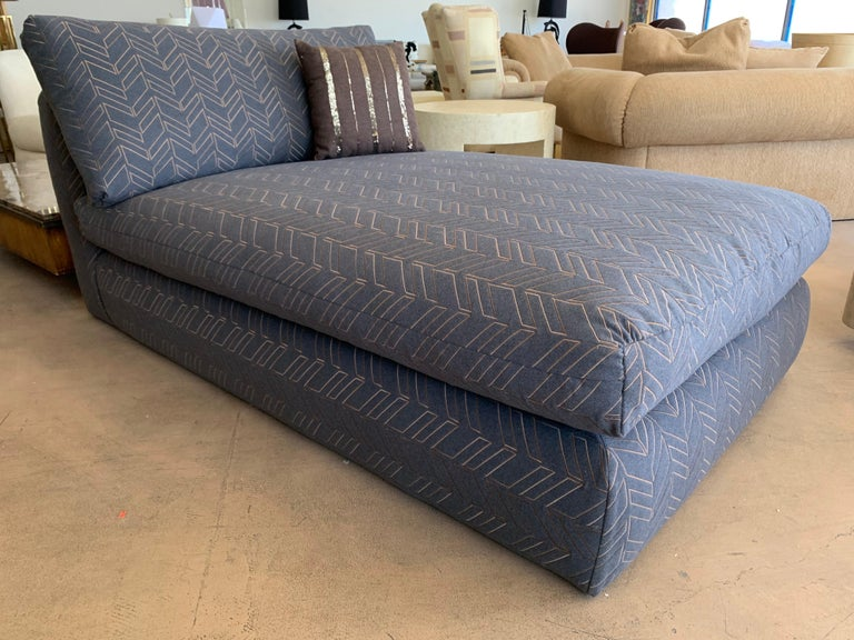 This amazing chaise lounge came from the multimillion dollar Ray Kroc estate that was entirely designed by legendary Steve Chase. We have redone it in a very high-end gray flannel fabric with bronze colored modernist Chevron embroidery. The chaise