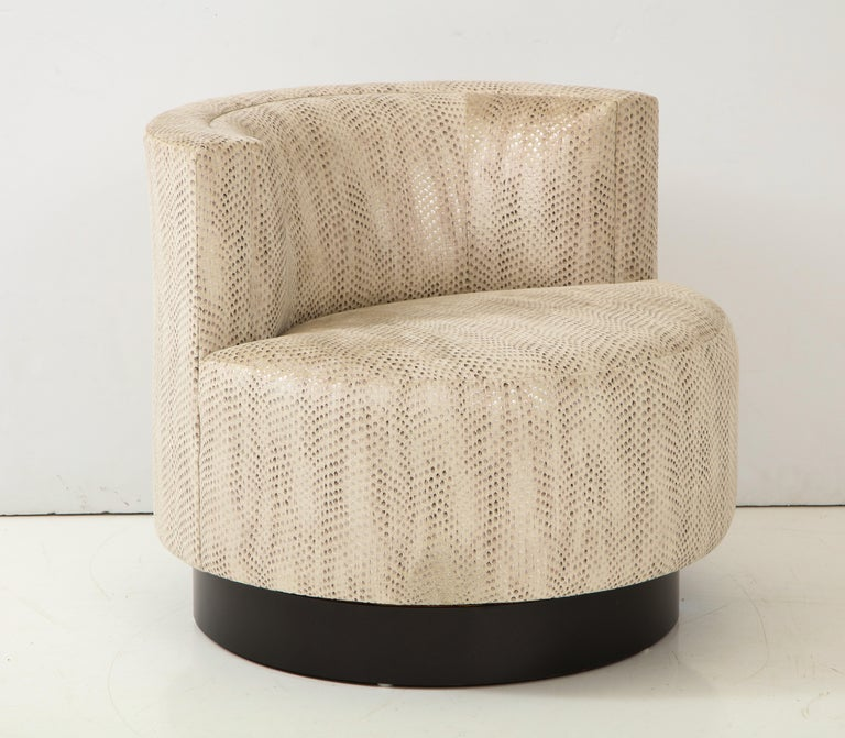 Elegant swivel chair designed by Steve Chase.